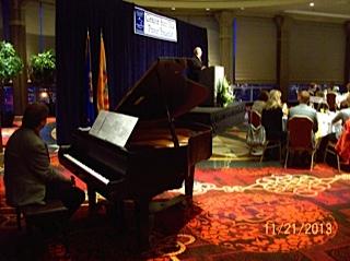 Musician Mike Palmer (at piano)